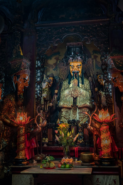 Offerings are laid before the Jade Emperor in the Jade Emperor Temple in Saigon