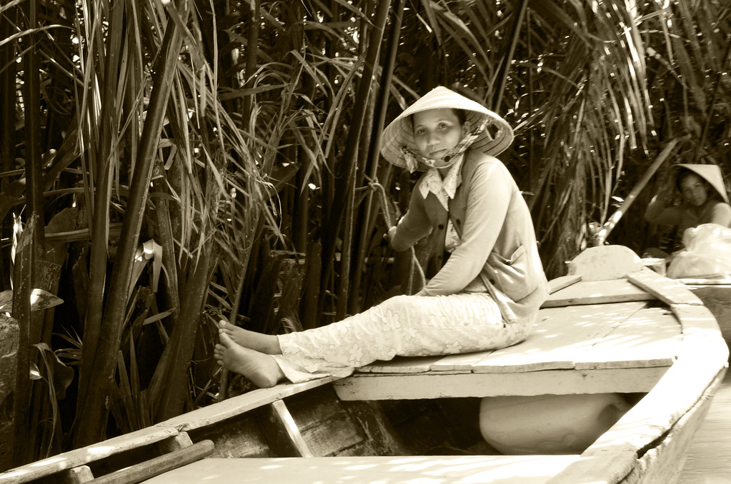 Boat's woman in the Mekong Delta