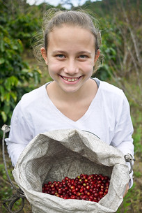 How cute is she?! Ana is pretty proud of her basket of bright red coffee cherries from the Akha Ama coffee fields.