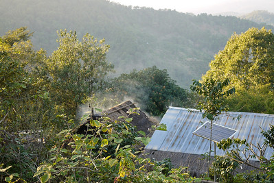 A house with disused solar panels in the Akha Ama coffee village near Chiang Mai, Thailand.