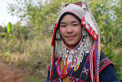 A beautiful traditional Akha villager showing us their traditional clothing at a coffee village near Chiang Mai, Thailand.