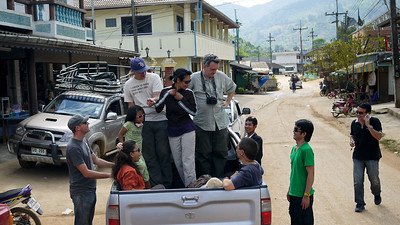 Switching from a songthaew to a pickup truck fro the journey up the mountain to the Akha Ama coffee village near Chiang Mai, Thailand.
