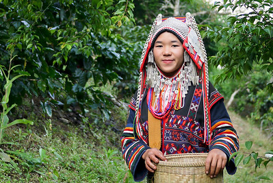 Villager displays the traditional Akha clothing in a coffee village near Chiang Mai, Thailand.