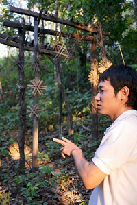 Lee explains the customs and beliefs of the Akha people in a coffee village near Chiang Mai, Thailand.