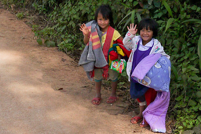 Sweet children smile and wave as we pass by on the way to the Akha Ama coffee village near Chiang Mai, Thailand.