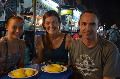 Grabbing some mango and sticky rice on Soi 38 with James from Nomadic Notes and my niece Ana.