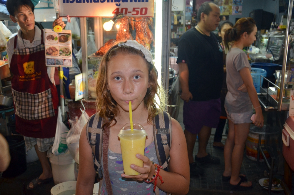 My niece enjoys a cold fruit smoothie on our last night in Thailand on Soi 38 in Bangkok.