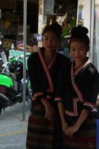 Two girls waiting backstage for their dance, Bo Sang Umbrella Festival, Chiang Mai, Thailand