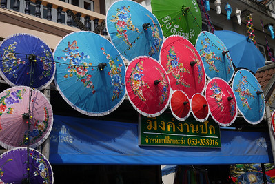 Colorful umbrellas line the streets at the Bo Sang Umbrella Festival, Chiang Mai, Thailand