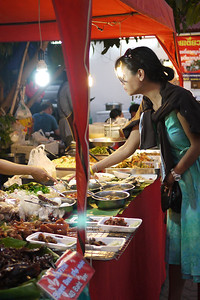 Food stalls at the Sunday night market, Chiang Mai, Thailand.