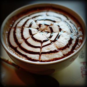 Pretty artwork on the foam of my mocha chocolate coffee!