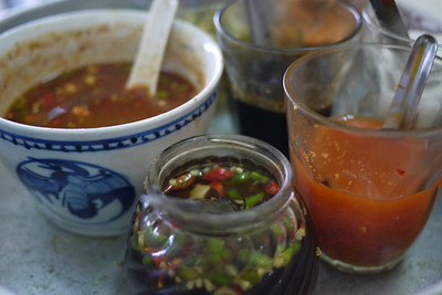 Table-top spice jars and sauces in Thailand.
