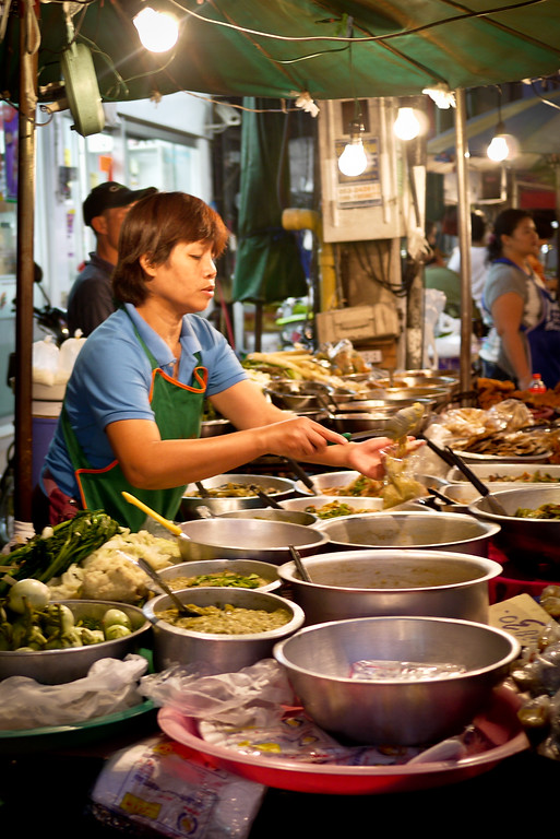 An array of cooked meals are ready to be served and eaten at the Chiang Mai Gate market in Thailand.
