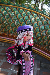 A young girl dresses in hilltribe clothes for the tourists, Chiang Mai, Thailand