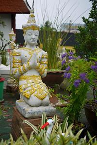 A pretty garden statue at a temple in Chiang Mai, Thailand
