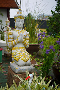 A pretty garden statue at a temple in Chiang Mai, Thailand