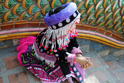 A young girl dresses in hiltribe clothes for the tourists in Chiang Mai, Thailand (Claire)