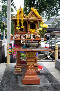 A spirit house near the police station in Chiang Mai, Thailand