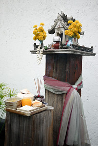 A spirit house and offering in Chiang Mai, Thailand