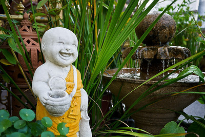 Happy monk at the Silver Temple, Wat Srisuphan,  in Chiang Mai, Thailand