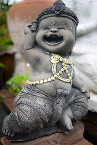a fat and happy statue at a temple in Chiang Mai, Thailand