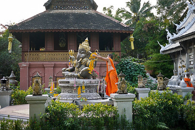 A monk cleaning the ganesh statue at Wat Srisuphan in Chiang Mai, Thailand