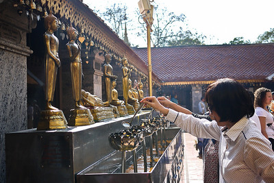 Making offerings at Doi Suthep in Chiang Mai, Thailand