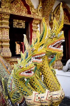 Elaborately decorated dragons at a temple (wat) in Chiang Mai, Thailand.