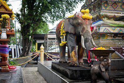 An elephant outside a spirit house near the police station in Chiang Mai, Thailand