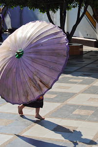 A young girl with her umbrella in Chiang Mai, Thailand (Claire)
