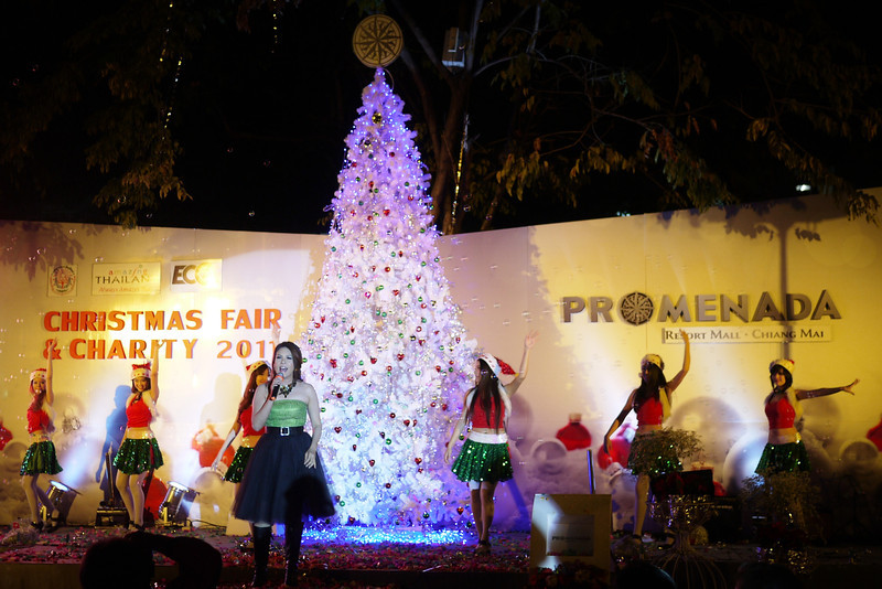 A Thai singer rocks out some holiday carols on stage.