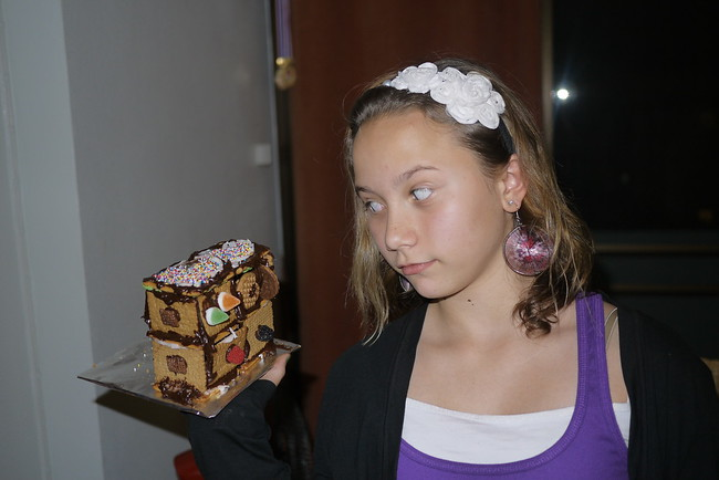 Ana eyes the candy on her gingerbread house!