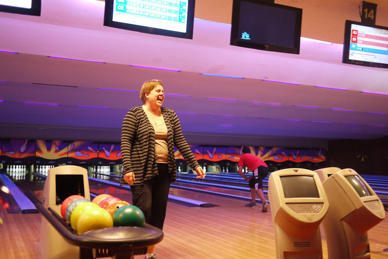Christine enjoys the feeling of hitting a strike at Christmas Eve bowling!
