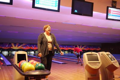 Christine enjoys the feeling of hitting a strike at Christmas Eve bowling!