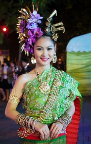 A beautiful Thai dancer in cheery red and green