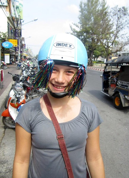 Ana chooses to keep her hat on, even with a motorbike helmet!