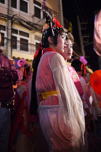 Dancers watch and wait their turn on stage at the Chinese New Year festivities in Chiang Mai, Thailand.