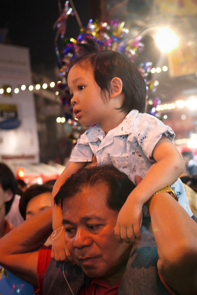 Little one on her dad's shoulders at the Chinese New Year festivities in Chiang Mai, Thailand.