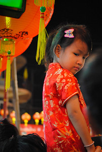 Shouldered little girl at the Chinese New Year festivities in Chiang Mai, Thailand.
