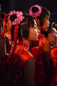 Child dancer rapt with attention at the Chinese New Year festivities in Chiang Mai, Thailand.