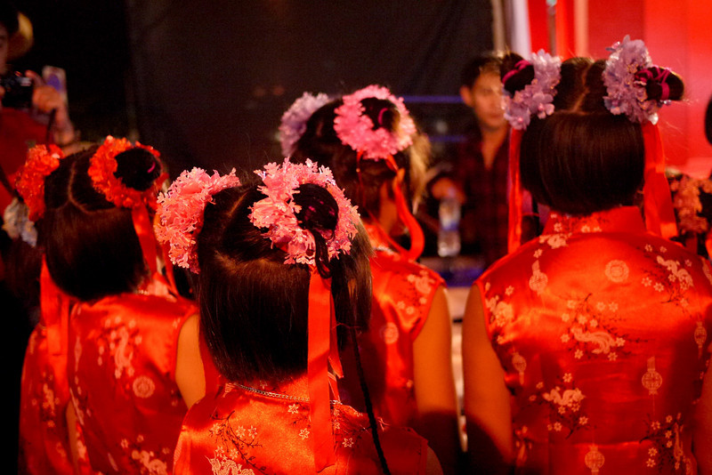 All are focused intently on the Chinese New Year festivities in Chiang Mai, Thailand.