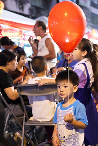 Little boy is very focused at the Chinese New Year festivities in Chiang Mai, Thailand.