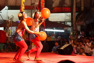 Ladyboys dancing on stage at the Chinese New Year festivities in Chiang Mai, Thailand.