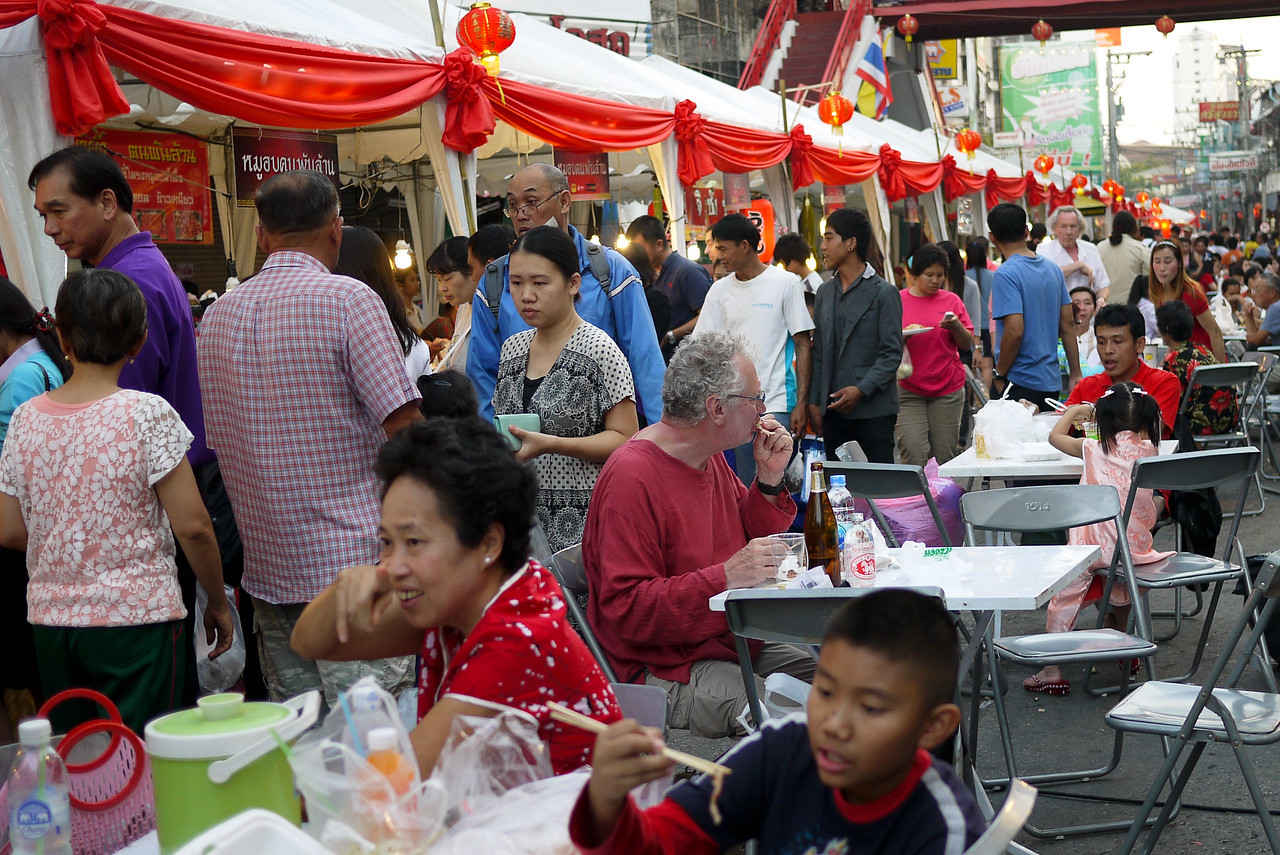 Crowds make use of foodstalls before the Chinese New Year festivities in Chiang Mai, Thailand.