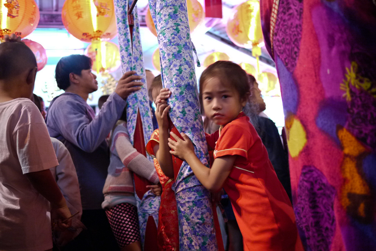 Children playing at the Chinese New Year festivities in Chiang Mai, Thailand.