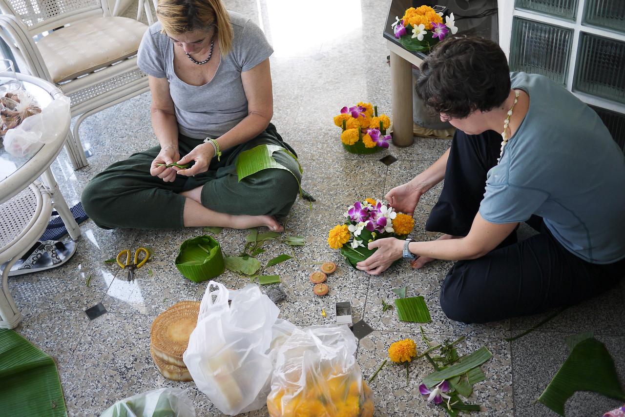 Naomi and Cathering make their krathongs during Loy Krathong in Chiang Mai, Thailand