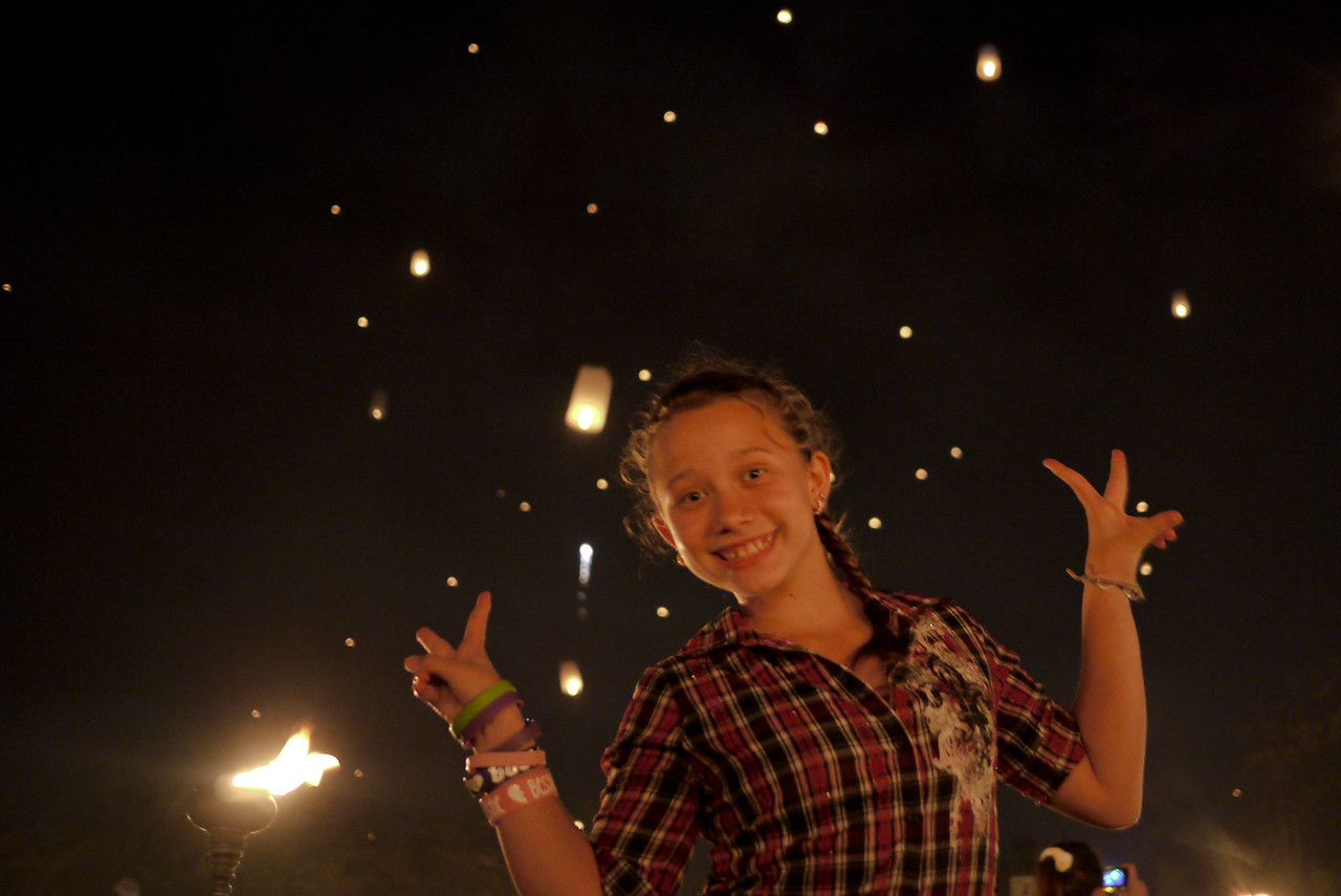 She learns quickly and flashes her peace signs during Loy Krathong in Chiang Mai, Thailand