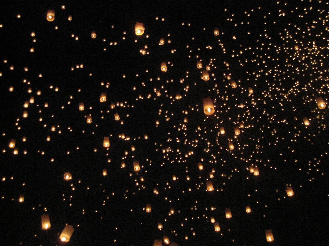 Lanterns in the night sky during Loy Krathong in Chiang Mai, Thailand