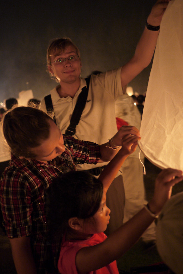 Dmitry does his part to make sure the top part of the lantern does not catch on fire during Loy Krathong in Chiang Mai, Thailand