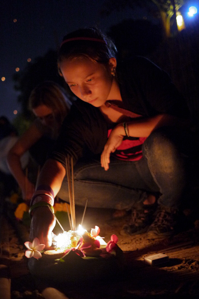 Ana lights her krathong for release during Loy Krathong in Chiang Mai, Thailand